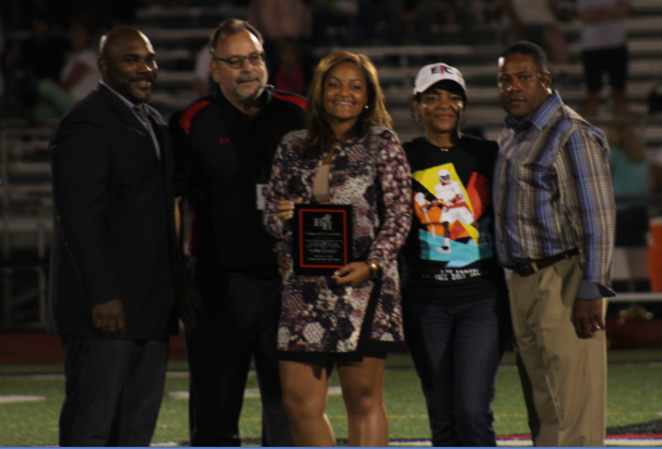 Hatboro-Horsham High School Principal Dennis Williams and Athletic Director Lou James stand with Erin Coombs, Tina Coombs and Eric Coombs after presenting the Wall of Fame honor for Edward's athletic achievements.