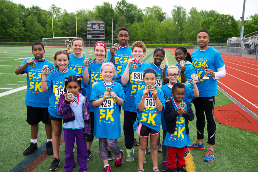 Winners of the EC34 5K show off their medals and trophies following the May 21 event.