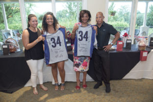 Billy Atkins presented No. 34 jerseys to Erin and Forrestine Coombs.
